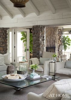 Great stone work mixed with white interior beams
