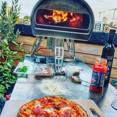 Kiss goodbye to your BBQ, turn your garden into an Italian restaurant. Buy Roccbox today, it is a portable, compact and lightweight stone bake oven.