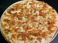 CRAB RANGOON PIZZA AT FONG'S PIZZA Cream cheese green onions spices crabmeat asiago mozzarella Parmesan and topped with sweet green chili sauce and crispy wonton wrappers