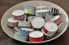 Wrap ribbon around tea lite candles. Cheap and easy.