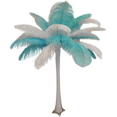 "This is our ""Tiffany"" ostrich feather centerpiece. It features white and mint feathers with a white eiffel tower vase. $44.95 each"