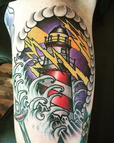 Traditional lighthouse tattoo Más