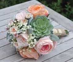 Peach and pink cabbage roses, babies breath and succulent faux flower bouquet by Holly's Wedding Flowers.