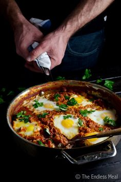 Easy make-ahead Harissa Shakshuka, which isone-pan eggs cooked in tomato sauce.