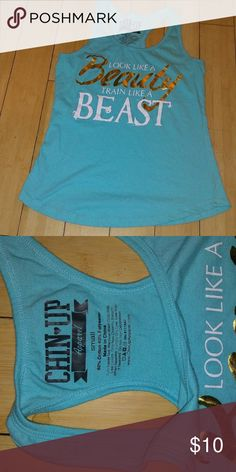 Workout tank top! Very cute running and workout tank, I bought it too small for me so never worn just missing the tags, downsizing from moving so all must go! I love offers and bundles, let me know if you have any questions or want information! Tops Tank Tops