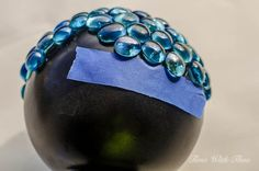 Use blue painter's tape to prevent glass beads from slipping and sliding / timewiththea.com