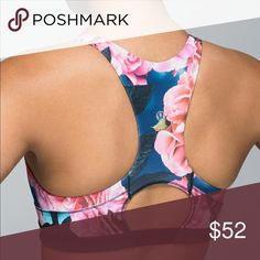 """Lululemon Secret Garden Top Speed Bra - 8 This is a like new Lululemon sports bra in a rare floral print. No pilling, mesh intact, & not stretched out. Good for dancing or yoga. Too tight for me and has barely been worn. The LuLu site says a size 8 would fit best for a 36"""" bust. There's a size dot. No pads included.  There are 2 tiny blue dots that I just noticed. One is on the racerback next to logo (Photo #4), & the other on is located on the front by left seam (Photo #5). You can barely…"""