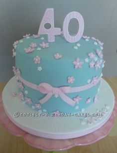 Pretty Pink and Blue 40th Birthday Cake... This website is the Pinterest of birthday cake ideas