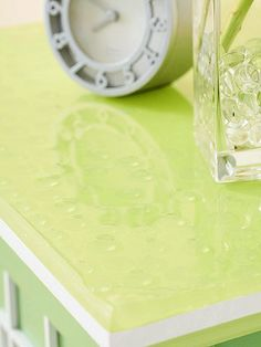 Clear glass beads used for floral displays add shine to this tabletop. They appear to float in several coats of ultra-gloss epoxy, which looks like glass when dry.