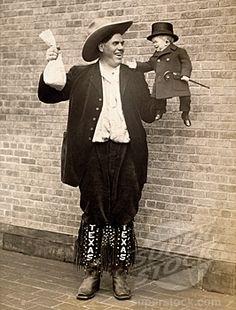 Texas Giant Jim Tarver holds Major Mite 1926