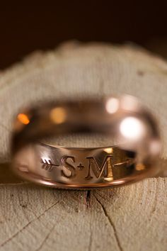 Love the initials + arrow inscribed on this wedding band {Aliza Rae Photography}