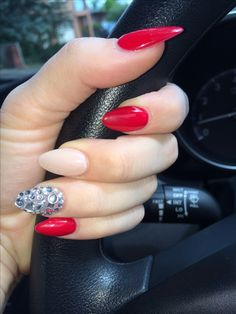 Solid nude with hot red and rhinestones Stilleto nails! The red is stunning and the diamonds finish the look perfectly love it :**