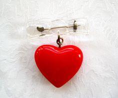 Vintage Lucite Plastic Bow & Red Puffy Heart Valentine Pin Bakelite Era Style. $22.00, via Etsy.