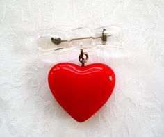 Vintage Lucite Plastic Bow & Red Puffy Heart Valentine Pin Bakelite Era Style. $22.00, via Etsy.