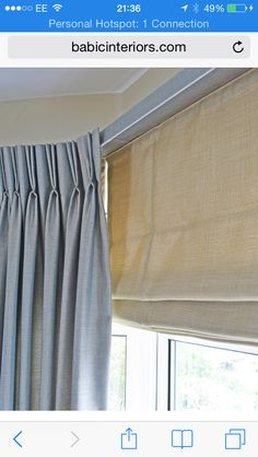 Curtains and roman blinds are a classic window treatment.