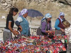 Local women selling handmade dolls outside Saratli, an underground city.