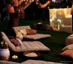 Backyard movie night. I want those comfy looking seats!