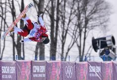 Canada's Derek Livingston jumps during the Men's Snowboard Halfpipe qualifications at the Rosa Khutor Extreme Park during the Sochi Winter Olympics on February 11, 2014. AFP PHOTO / DIMITAR DILKOFF (Photo credit should read DIMITAR DILKOFF/AFP/Getty Images).