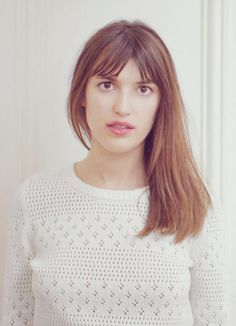Jeanne Damas with straight brunette hair and fringe for &other stories