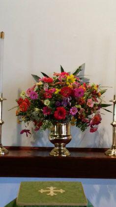 New Garden Club Journal       fresh cut zinnias find their way to the church alter in this traditional mass floral design.      Flower arrangement.