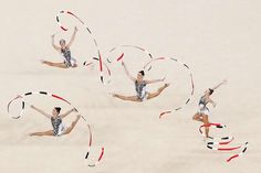 Team Uzbekistan compete during the ribbon rotation 1 in the group all-round qualification round at the at 2016 Rio Olympic games.