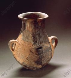 Nuragic civilization. Pear-shaped pitcher with engraved decorations. From Sardinia Region. Villanovaforru, Museo Archeologico 'Genna Maria' (Archaeological Museum)