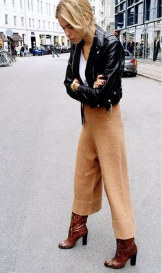 Knit camel trouser pants, moto leather jacket, and boots.