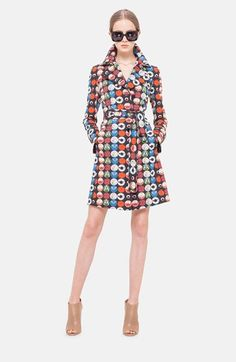 Akris punto Record Print Cotton Trench Coat at Nordstrom.com. Retro vinyls lend colorful and graphic appeal to a streamlined trench coat tailored in crisp cotton. The covered button placket reinforces the style's clean-lined appeal, while an inverted button-tab back pleat adds a touch of feminine flair.