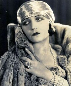 Silent film star Pola Negri is credited with starting the Turban fashion