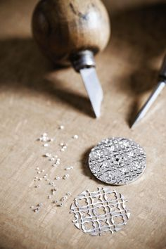 A craftsman at Louis Vuitton's watchmaking atelier setting diamonds on the dial of a Dentelle de Monogram watch.