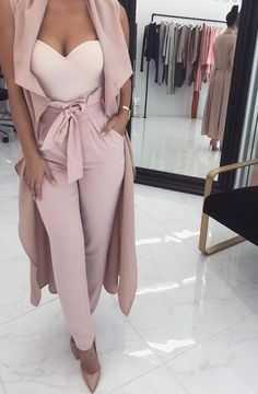 You will never go wrong with a pair of high-waist pants that comes in such a beautiful shade. Mix it with a long sleeveless cape for a Valentine's Day pastel outfit.