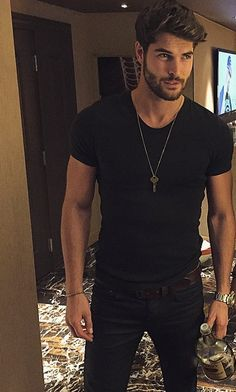 Nick Bateman - the whole look - black denims, black T-shirt, the necklace, his hair and beard.