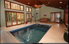 An Original Endless Pools swimming machine installed indoors and fully in-ground in a sunroom in Edison, New Jersey. Endless Pools, Indoor Pools, Sunroom Ideas, Water Element, Modular Design, Hot Tubs, Home And Family, Garage, Swimming