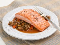 Salmon with Lentils Recipe : Ina Garten : Food Network - FoodNetwork.com  Made this tonight.  Good flavor but I slightly overcooked the lentils, which resulted in it having less 'sauce.' Very good an will make again.