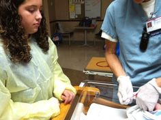 11-year-old Lauren, shadowing NICU nurse Julie, learns how to do a heel stick.