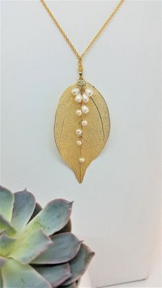 33fb7424d #leafnecklace This statement necklace has beautiful gold leaf made with a  real leaf, delicately