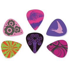 Pick your style! These durable, medium gauge guitar picks are the perfect accessory for those who want play with a softer touch, whether on acoustic, electric, or bass. This package of 12 features six different color and graphic combinations with fun, stylish designs to match your mood.