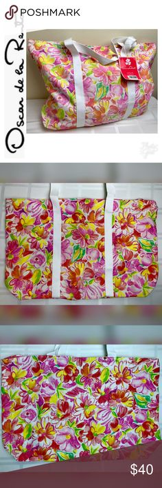 """Oscar de la Renta Signature Canvas Tote Bag Oscar de la Renta Signature Canvas Tote Bag in a Beautiful Wild Flower Design on White Canvas with White Trim and Handles, Snap Top Closure, Measures Approx. 15""""x 22 1/2""""x 4 3/4"""", This Wildflower Weekender Tote is Perfect for those Quick Weekend Get Aways! Oscar de la Renta Bags Totes"""