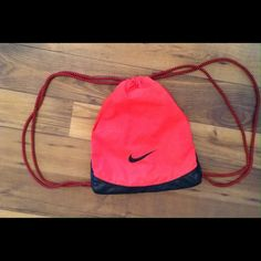 Nike Draw String Bag Reddish- pinkish Nike bag. Has a few minor scratches. Nike Bags