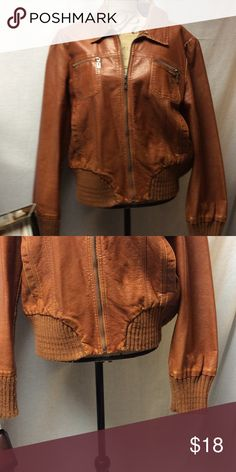Retro faux leather jacket Retro faux leather jacket ready for that fall day. Sweater trim with distressed look. Rock it with a pair for d distressed jeans and nice scarf and you are game day or tailgate ready. Priced to purge from closet. Rust colored Xhilaration Jackets & Coats