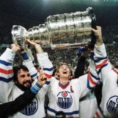 Wayne Gretzky and a bearded Paul Coffey hoist the Stanley Cup on May 19 It was the first Stanley Cup championship for the Edmonton Oilers. Photo by Mike Pinder Edmonton Journal Hockey Teams, Ice Hockey, Sports Teams, Hockey Rules, Hockey Sport, Nhl Jerseys, Edmonton Oilers, Lord Stanley Cup, Nhl Wallpaper