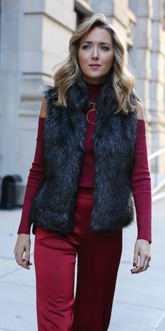 burgundy red satin wide leg pants, burgundy red ribbed knit cold shoulder mock neck sweater, charcoal grey faux fur vest, geometric circle gold statement necklace