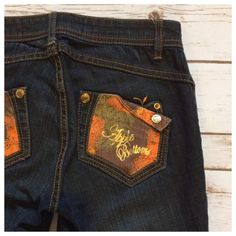 "Apple Bottoms jeans Straight cut jeans in overall dark wash. Apple Bottoms detailing on back pockets. Excellent condition - worn just one time. Size 7/8; Measurements when laying flat: 15.5"" waist, 31"" inseam, 7.5"" front rise. Apple Bottoms Jeans Straight Leg"