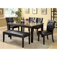 Versatile in setting, this modern six piece dining set provides plenty of surface space to accommodate cozy get-togethers. The four chairs and spacious bench provide plenty of cushions for hours of enjoyment!