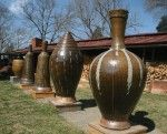 Wood fired with salt glaze. 60 inches and 250 pounds for the big one!