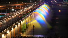 The Moonlight Rainbow Fountain is the world's longest bridge fountain, measuring a spectacular 1,140 meters (3,740 feet) long. Installed in 2009 on the Banpo Bridge, the fountain repeatedly pumps water from the Han River below in an effort to remain eco-friendly. Along each side of the bridge, 380 nozzles spray water 140 feet horizontally. As the water jets sway to a wide selection of music, 10,000 LED nozzles illuminate them, creating a rainbow effect.