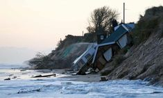 Collapsed houses lie on the beach after a storm surge in Hemsby, Norfolk, in 2013. Greenland Ice Melt, Storm Surge, Sea Level, Extreme Heat, Extreme Weather, East Coast, Global Warming, Climate Change, Coastal