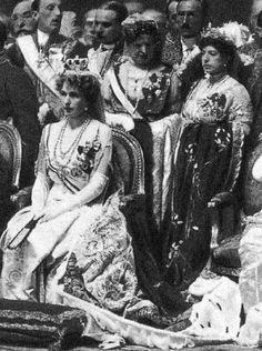 Queen Victoria Eugenia of Spain (sitting).