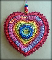 Ravelry: Heart - Adele Hanging Heart pattern  I've seen a version of this in pinks and reds with beads. Just beautiful