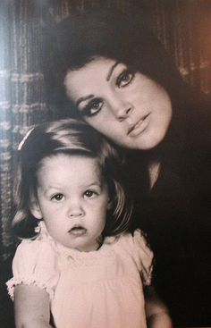 Lisa Marie & Pricilla Presley... seriously, no one can ever deny lisa Marie is not his kid.  They are identical, even more so as she grew up...
